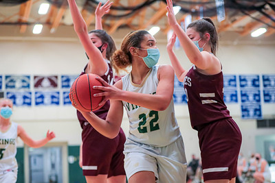 Guarded by Edward Little's Erin Cowie (left) and Jenny Chaput, Oxford Hills' Viktoria Sugars looks for an open teammate at their game in South Paris.
