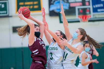 Edward Little's Jenny Chaput is pressured by Vikings Cassidy Dumont (center) and Ella Kellogg at their game in South Paris.