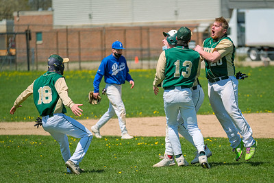 Ethan Cutler, partially obscurred, is congratualted by teammates  (r-l) Isaiah Oufiero, Wyatt Knightly and Ty LeBlond after driving in the winning run in the 7th inning in the first game of a double header in against Lewiston in South Paris.