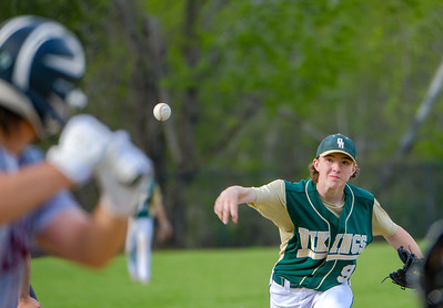 Oxford Hills' Kolby Brown delivers a curve ball in the early innings during his game with Edward Little in South Paris.