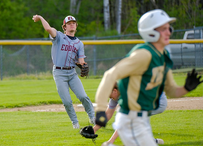 Edward Little third baseman Chase Martin throws out Oxford Hills' Ethan Cutler after a sacrifice bunt during their game with Oxford Hills in South Paris.