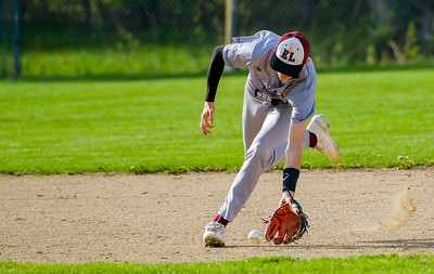 Edward Little shortsop Patrick Anthoine fields a ground ball during his game with Oxford Hills in South Paris.