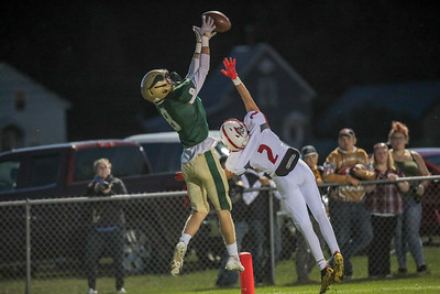 Vikings wide receiver Teigan Pelletier goes up and over Sanford's LJ McFarland to haul in a pass for a touchdown.