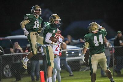 Oxford Hills' Matt Doucette, Teigan Pelletier and Isaiah Oufiero celebrate after a touchdown.