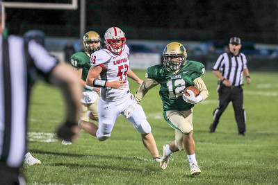 Oxford Hills' Matt Doucette gets around the left side on a punt return in the first half of his game at the Gouin complex in South Paris.