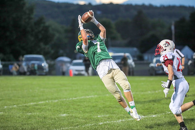 Oxford Hills' Dakota Grassi hauls in a long pass from Oxford Hills quarterback Eli Soehren in the first half of their game at the Gouin complex in South Paris.