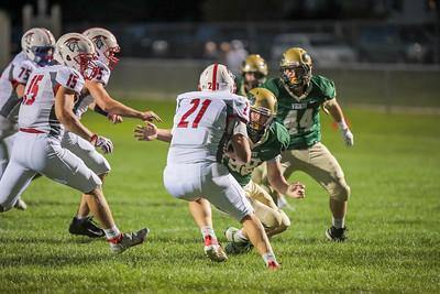 Sanford Quarterback Jordan Bossonnette tries to get by Viking linebacker Dillon Worster who prepares to make the tackle.