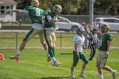 Oxford Hills' Teigan Pelletier (left) is congratulated by Wyatt Knightly after catching a touchdown pass.