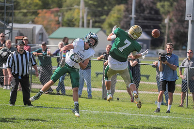 Oxford Hills' Dakota Grassi almost comes up with the catch as Bonney Eagle's Trevor Perkins looks on.