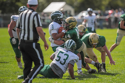 Bonney Eagle quarterback Terrell Edwards is met at the line by Oxford Hills linebacker Isaiah Oufiero.
