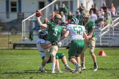 On Oxford Hills' opening drive, quarterbck Eli Soehren throws the ball away as Bonney Eagle's Broderick Ernst tries to tackle him.