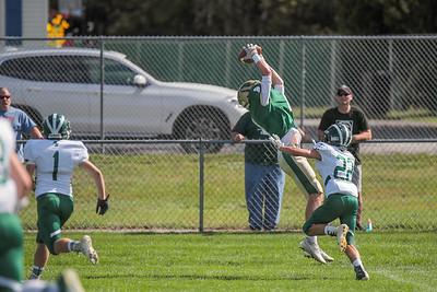 Oxford Hills' Teigan Pelletier goes up to make the catch over Bonney Eagle's Trevor Perkins.