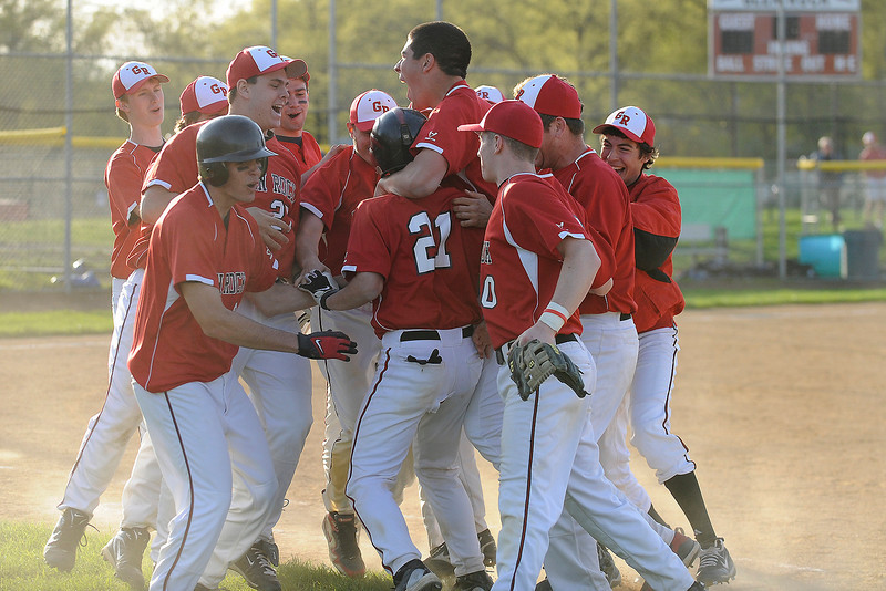 04/12/2010...Tyler Blind (21) of Glen Rock gets congratulated in the seventh inning after hitting a single with the bases loaded to give the Panthers the winning run in their 5-4 win over Hawthorne<br /> PHOTO: KELLY BIRDSEYE