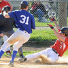 04/12/2010...Glen Rock's Lou Karcanes (3) slides in safe stealing home plate in the second inning against Hawthorne.<br /> PHOTO: KELLY BIRDSEYE