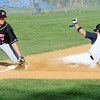 03/14/2010...Ramsey's John Capuano (8) is safe at third base ahead of the throw to Northern Highlands' third baseman Kyle Koppel (7).<br /> PHOTO: KELLY BIRDSEYE