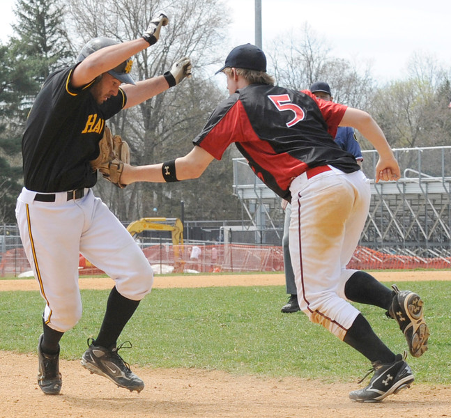 Glen Rock third baseman Dillion White (5 right) catches River Dell's Brian Lavalle (5) between second and third base for an out.<br /> PHOTO: KELLY BIRDSEYE