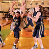 1-26-2010...Indian Hills and Ramapo player perform a dance as they  vie for a rebound.<br /> PHOTO: KELLY BIRDSEYE