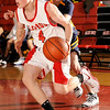Glen Rock's Brett Lederer (4) had 14 points, drives around Jim Callahan in a 54-52 loss to Ramsey.<br /> PHOTO: KELLY BIRDSEYE