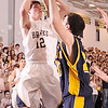 3-9-2010...Ryan Van Grouw (12) of  Indian Hills had the team high scoring of 15 points, shoots over the defense of Pequannock's Jordon Tabakman in the North 1, Group 2 championship game.<br /> PHOTO: KELLY BIRDSEYE