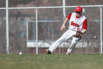 Cheshire's Zach Barlok (21) tracks down a ground ball Monday at Sheehan High School in Wallingford  Apr. 13, 2015 | Justin Weekes / For the Record-Journal