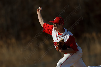 Cheshire's Ben DeLaubell (11) delivers a pitch in the first inning Monday at Sheehan High School in Wallingford  Apr. 13, 2015 | Justin Weekes / For the Record-Journal