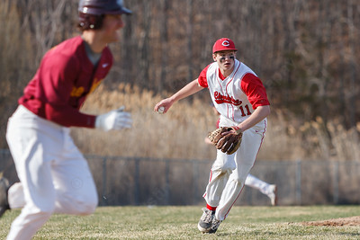 Cheshire's Ben DeLaubell (11) turns to first after stopping a hit from Sheehan's Sal Gozzo (27)  Monday at Sheehan High School in Wallingford  Apr. 13, 2015 | Justin Weekes / For the Record-Journal