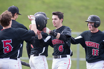 Cheshire's celebrates after scoring three in the first off a double from Gary Costello  Monday at Sheehan High School in Wallingford Apr. 11, 2016 | Justin Weekes / For the Record-Journal