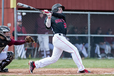 Cheshire's Gary Costello takes Sheehan's pitcher James Judenis deep to center to clear the bases with a double Monday at Sheehan High School in Wallingford Apr. 11, 2016 | Justin Weekes / For the Record-Journal