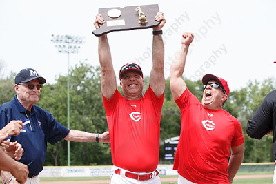 Cheshire's head coach Bill Mrowka raises the Class LL trophy with assistant coach Mike Lussier Saturday during the CIAC Class LL final at Palmer Field in Middletown. Cheshire Rams defeated Ridgefield 1-0  May 31, 2016 | Justin Weekes / Special to the Record-Journal