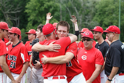 Cheshire's Ben DeLaubell gets a hug from head coach Bill Mrowka Saturday during the CIAC Class LL final at Palmer Field in Middletown. Cheshire Rams defeated Ridgefield 1-0  May 31, 2016 | Justin Weekes / Special to the Record-Journal