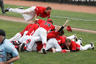 Cheshire's Ryan Strollo lands on top of the pile to celebrate Saturday during the CIAC Class LL final at Palmer Field in Middletown. Cheshire Rams defeated Ridgefield 1-0  May 31, 2016 | Justin Weekes / Special to the Record-Journal