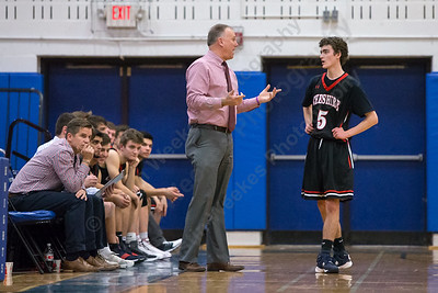 Cheshire's head coach Dan Lee talks with James Pettit Monday at Southington High School in Southington February 5, 2018 | Justin Weekes / Special to the Record-Journal