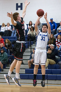 Southington's Jeremy Mercier gets off a three point shot as Cheshire's Will Graikoski tries to block Monday at Southington High School in Southington February 5, 2018 | Justin Weekes / Special to the Record-Journal