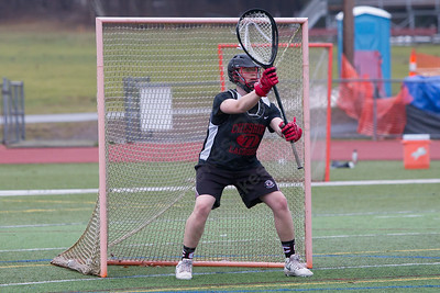 Cheshire's Peter Brown gets set for a shot Wednesday during practice at Cheshire High School in Cheshire Mar. 28, 2017 | Justin Weekes / For the Record-Journal
