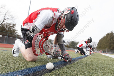Cheshire's Dylan Hick practices face offs Wednesday at Cheshire High School in Cheshire March 28, 2018 | Justin Weekes / Special to the Record-Journal