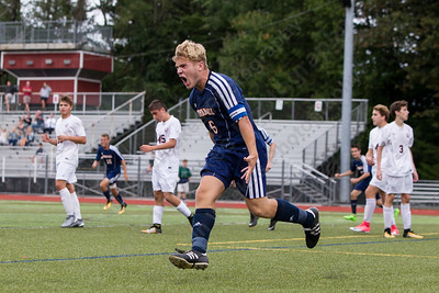 Lyman Hall's Jack Gaynor celebrates after scoring late in the first half putting the Trojans up 1 to nil Wednesday at Alumni Field in Cheshire. The match ended in a tie 1 to 1. September 20, 2017 | Justin Weekes / For the Record-Journal