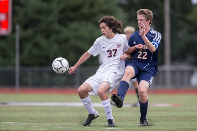 Lyman Hall's Kevin Ransom challenges Cheshire's Toby Goldstein Wednesday at Alumni Field in Cheshire. The match ended in a tie 1 to 1. September 20, 2017 | Justin Weekes / For the Record-Journal