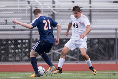 Cheshire's Evan Esposito challenges Lyman Hall's Quinn Crowther Wednesday at Alumni Field in Cheshire. The match ended in a tie 1 to 1. September 20, 2017 | Justin Weekes / For the Record-Journal