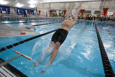 Cheshire's Sam Hanke leaves the block to start the 200 medley relay Tuesday at the Cheshire Community Pool in Cheshire February 13, 2018 | Justin Weekes / Special to the Record-Journal