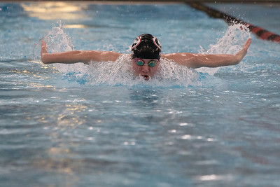 Cheshire's Shane Wynne swims the butterfly stroke in the 200 medley relay Monday at the Cheshire Community Pool in Cheshire  December 17, 2018 | Justin Weekes / Special to the Record-Journal