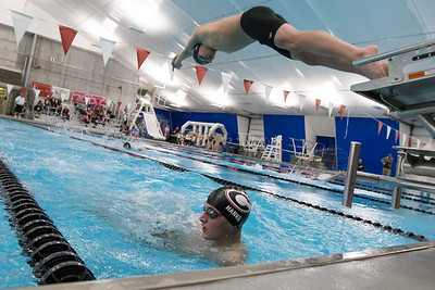 Cheshire's Vincent Zhu leaves the block in the 200 medley relay Monday at the Cheshire Community Pool in Cheshire  December 17, 2018 | Justin Weekes / Special to the Record-Journal
