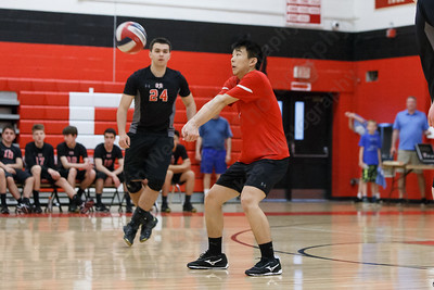 Cheshire's Berkley Fang digs a serve Wednesday at Cheshire High School in Cheshire May 23, 2018 | Justin Weekes / Special to the Record-Journal