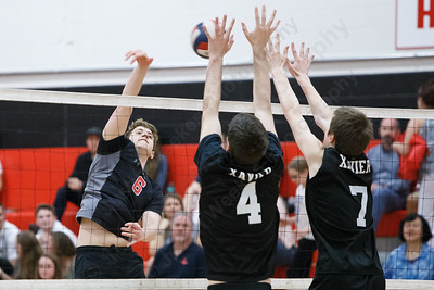Cheshire's Alex Feldman drives a spike through blockers Wednesday at Cheshire High School in Cheshire May 23, 2018 | Justin Weekes / Special to the Record-Journal