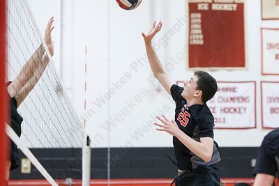Cheshire's Colby Hayes  touches over blockers Wednesday at Cheshire High School in Cheshire May 23, 2018   Justin Weekes / Special to the Record-Journal