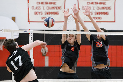 Cheshire's Colby Hayes (25) and Thomas Bonitz jump to block Wednesday at Cheshire High School in Cheshire May 23, 2018 | Justin Weekes / Special to the Record-Journal