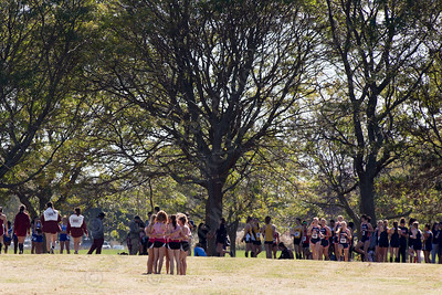 Cheshire's girls varsity cross country team take a moment before the start Thursday during the SCC Cross Country finals at East Shore Park in New Haven October 19, 2017 | Justin Weekes / For the Record-Journal