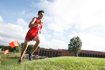 Cheshire's Brendon Mellitt stretches his lead Wednesday at Sheehan High School in Wallingford September 26, 2018 | Justin Weekes / Special to the Record-Journal
