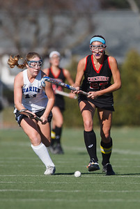Cheshire's Olivia Larson (27) geta past Darien's Sloane Bessey (11) Saturday at Cottone Field in Wethersfield  Nov., 16 2013 | Justin Weekes / For the Record-Journal