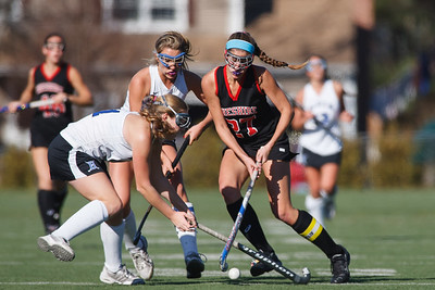 Cheshire's Olivia Larson (27) cuts through Darien's Sloane Bessey (11) and Jackie Brokaw (20)  Saturday at Cottone Field in Wethersfield  Nov., 16 2013 | Justin Weekes / For the Record-Journal