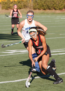Cheshire's Kya O'Donnell (34) cuts to get by Darien's Hollis Perticone (15) Saturday at Cottone Field in Wethersfield  Nov., 16 2013 | Justin Weekes / For the Record-Journal